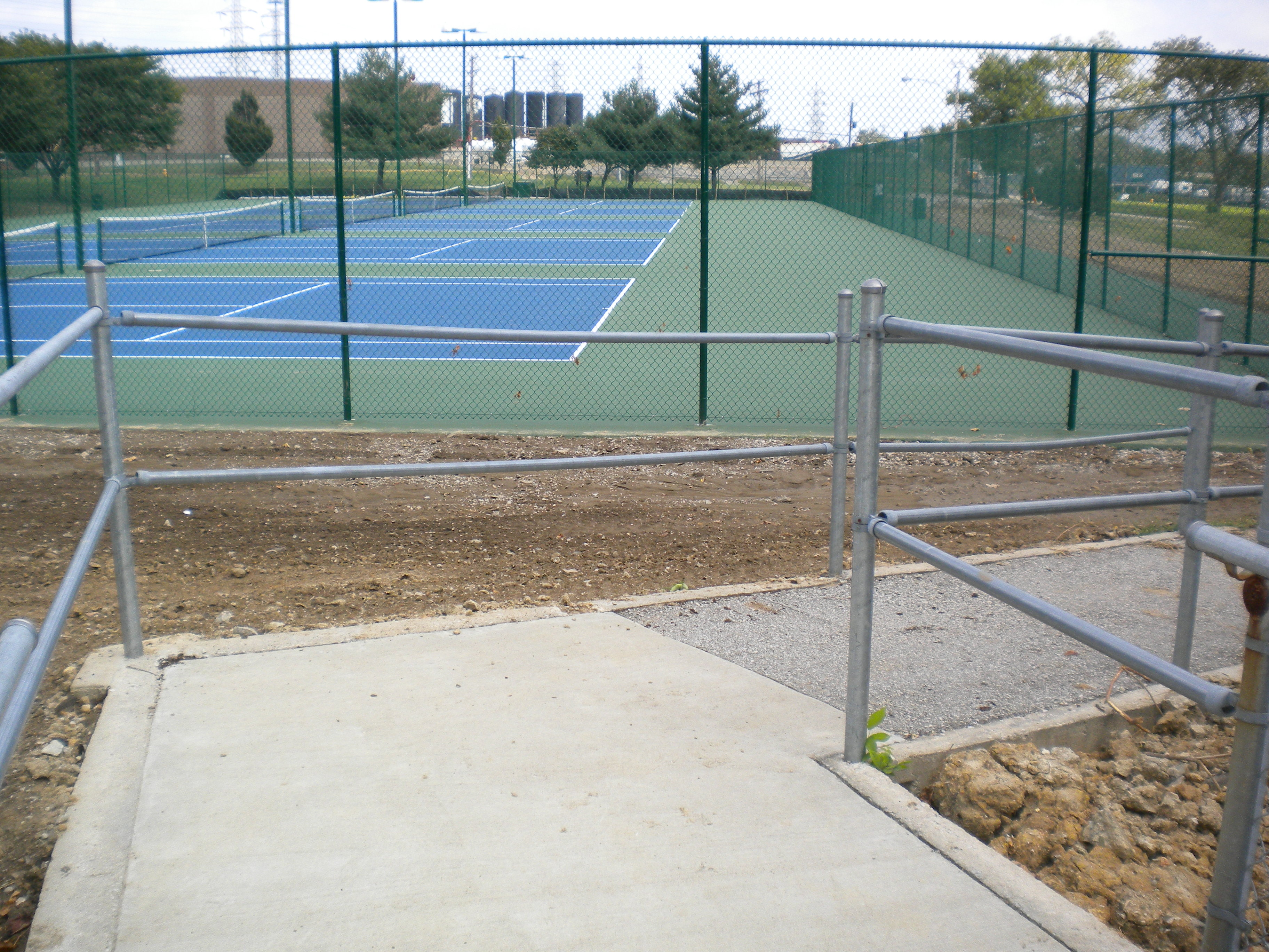 Paved path overlooking the tennis courts